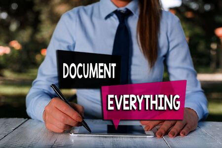 Handwriting text Document Everything. Conceptual photo computer file that contains text that you have written Female business person sitting by table and holding mobile phone