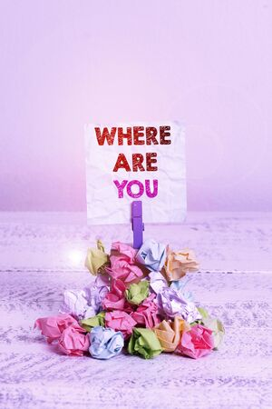 Handwriting text Where Are You. Conceptual photo Give us your location address direction point of reference Reminder pile colored crumpled paper clothespin reminder white wooden space