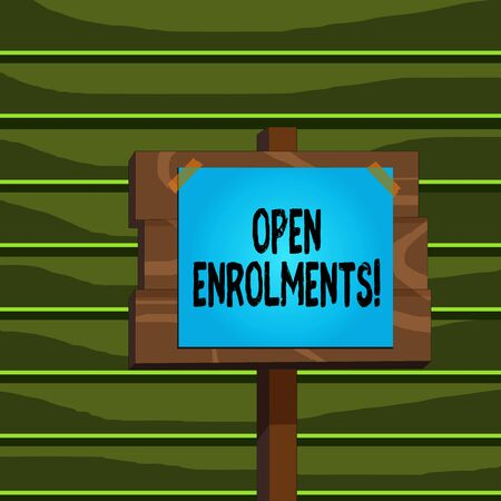 Conceptual hand writing showing Open Enrolments. Concept meaning when employees may make changes to elected fringe benefit Wood plank wood stick pole paper note attached adhesive tape Stock fotó
