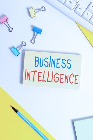 Conceptual hand writing showing Business Intelligence. Concept meaning Best Practice of Information to Optimize Performance Flat lay with pc keyboard and copy space for text messages Stock Photo