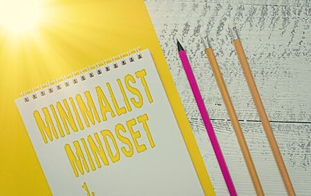 Handwriting text Minimalist Mindset. Conceptual photo Be more Aware what Life can Offer without Clutter Blank spiral notepad colored paper sheet markers retro wooden background