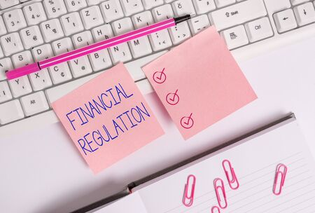Handwriting text Financial Regulation. Conceptual photo aim to Maintain the integrity of Finance System Flat lay above blank copy space sticky notes with business concept Standard-Bild