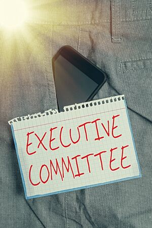 Writing note showing Executive Committee. Business concept for Group of Directors appointed Has Authority in Decisions Smartphone device inside trousers front pocket note paper