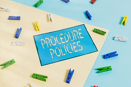Text sign showing Procedure Policies. Business photo showcasing Steps to Guiding Principles Rules and Regulations Colored clothespin paper empty reminder yellow blue floor background office