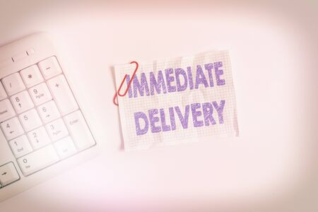 Writing note showing Immediate Delivery. Business concept for Send it Now Custom Procedure to dispose Promptly White pc keyboard with empty note paper above white background