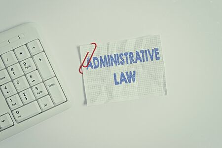 Writing note showing Administrative Law. Business concept for Body of Rules regulations Orders created by a government White pc keyboard with empty note paper above white background