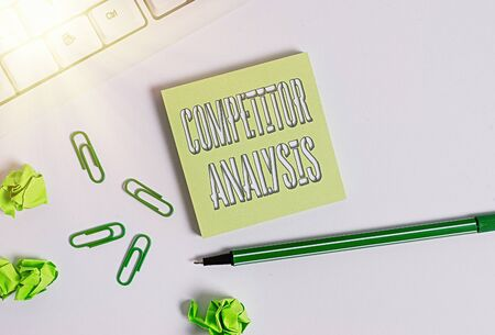 Text sign showing Competitor Analysis. Business photo showcasing Determine the Strength Weakness of Competitive Market Square empty green note paper with pencil on the white background and pc keyboard
