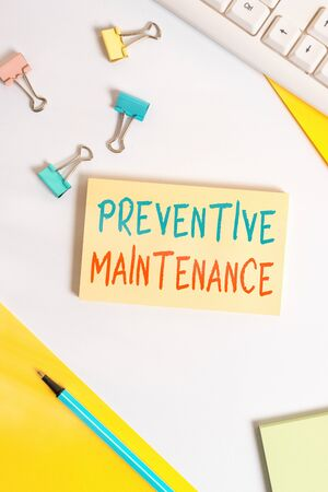 Conceptual hand writing showing Preventive Maintenance. Concept meaning Avoid Breakdown done while machine still working Flat lay with pc keyboard and copy space for text messages