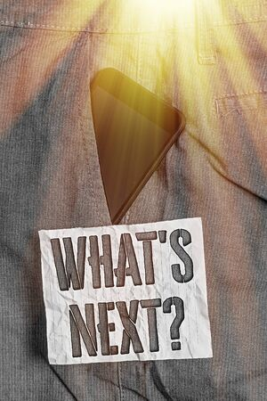 Text sign showing What S Next Question. Business photo text Get information Ask Query Investigate Probes Explore Smartphone device inside formal work trousers front pocket near note paper