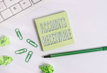 Text sign showing Accounts Receivable. Business photo showcasing Legal Claim of Payment Money Owed to by Debtors Square empty green note paper with pencil on the white background and pc keyboard