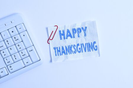 Writing note showing Happy Thanksgiving. Business concept for Harvest Festival National holiday celebrated in November White pc keyboard with empty note paper above white background
