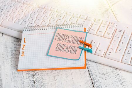 Word writing text Professional Education. Business photo showcasing Continuing Education Units Specialized Training notebook paper reminder clothespin pinned sheet white keyboard light wooden
