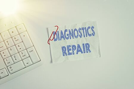 Writing note showing Diagnostics Repair. Business concept for A program or routine that helps a user to identify errors White pc keyboard with empty note paper above white background