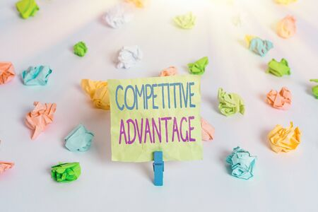 Writing note showing Competitive Advantage. Business concept for Company Edge over another Favorable Business Position Colored crumpled paper empty reminder white floor clothespin Foto de archivo