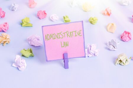 Text sign showing Administrative Law. Business photo text Body of Rules regulations Orders created by a government Colored crumpled papers empty reminder blue floor background clothespin
