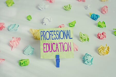 Writing note showing Professional Education. Business concept for Continuing Education Units Specialized Training Colored crumpled paper empty reminder white floor clothespin
