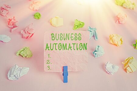 Handwriting text Business Automation. Conceptual photo for Digital Transformation Streamlined for Simplicity Colored crumpled papers empty reminder pink floor background clothespin