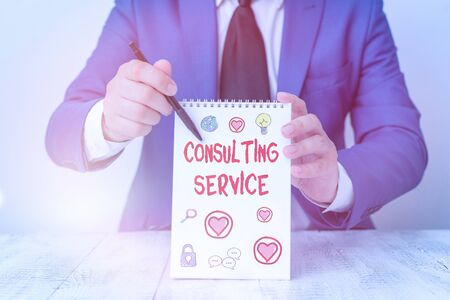 Conceptual hand writing showing Consulting Service. Concept meaning Experts that offers knowledge to a third party for a fee 写真素材
