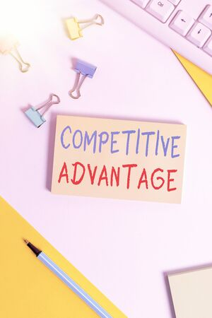 Conceptual hand writing showing Competitive Advantage. Concept meaning Company Edge over another Favorable Business Position Flat lay with pc keyboard and copy space for text messages 写真素材
