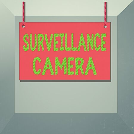 Conceptual hand writing showing Surveillance Camera. Concept meaning Closed Circuit Television transmit signal on monitors Wooden board wood empty frame fixed colorful striped string