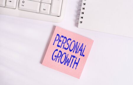 Word writing text Personal Growth. Business photo showcasing improve develop your skills qualities Learn new materials Empty note paper on the white background by the pc keyboard with copy space