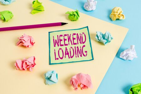 Conceptual hand writing showing Weekend Loading. Concept meaning Starting Friday party relax happy time resting Vacations Colored crumpled paper empty reminder blue yellow clothespin