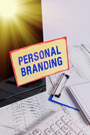 Conceptual hand writing showing Personal Branding. Concept meaning Practice of People Marketing themselves Image as Brands Note paper taped to black screen near keyboard stationary Foto de archivo