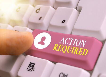 Writing note showing Action Required. Business concept for Regard an action from someone by virtue of their position