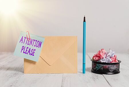 Writing note showing Attention Please. Business concept for Asking showing to focus their mental powers on you Envelope sticky note marker paper balls container wooden background