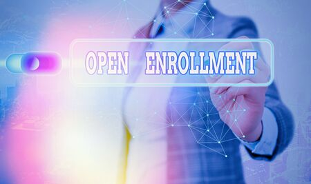 Writing note showing Open Enrollment. Business concept for The yearly period when showing can enroll an insurance
