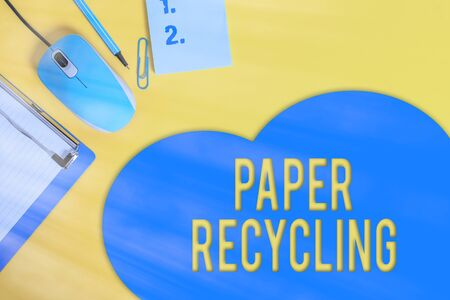 Word writing text Paper Recycling. Business photo showcasing Using the waste papers in a new way by recycling them Metal clipboard blank paper sheet clip mouse pencil note colored background