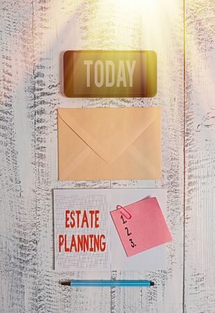Word writing text Estate Planning. Business photo showcasing The management and disposal of that an individual s is estate Envelop smartphone notepad note clip marker old wooden vintage background