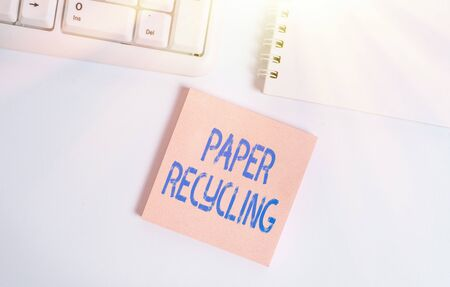 Word writing text Paper Recycling. Business photo showcasing Using the waste papers in a new way by recycling them Empty note paper on the white background by the pc keyboard with copy space