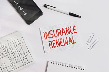 Writing note showing Insurance Renewal. Business concept for Protection from financial loss Continue the agreement Flat lay above computer mobile phone pencil and copy space note paper