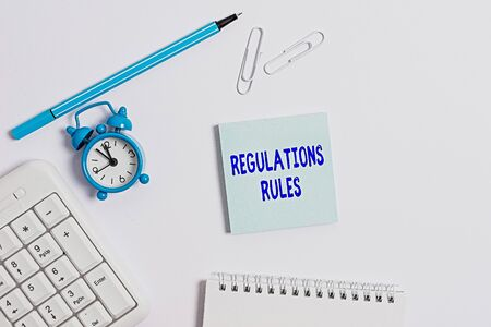 Conceptual hand writing showing Regulations Rules. Concept meaning Standard Statement Procedure govern to control a conduct Copy space on empty note paper with clock and pencil on the table
