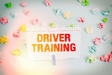 Text sign showing Driver Training. Business photo showcasing prepares a new driver to obtain a driver s is license Colored crumpled papers empty reminder blue floor background clothespin