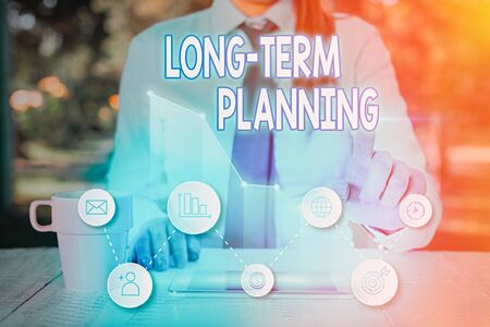 Handwriting text Long Term Planning. Conceptual photo Establish Expected Goals five or more years ahead