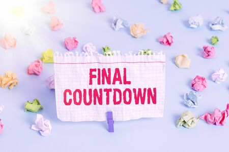 Text sign showing Final Countdown. Business photo showcasing Last moment of any work having no posibility of discusion Colored crumpled papers empty reminder blue floor background clothespin