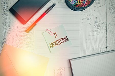Text sign showing It Architecture. Business photo showcasing Architecture is applied to the process of overall structure Smartphone sheet clips ballpoint notebook envelope note wooden background