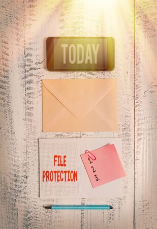 Word writing text File Protection. Business photo showcasing Preventing accidental erasing of data using storage medium Envelop smartphone notepad note clip marker old wooden vintage background