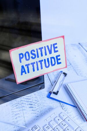 Conceptual hand writing showing Positive Attitude. Concept meaning Being optimistic in Life Looking for good things Note paper taped to black screen near keyboard stationary