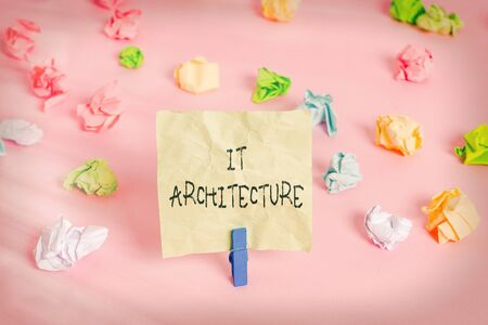 Conceptual hand writing showing It Architecture. Concept meaning Architecture is applied to the process of overall structure Colored crumpled papers empty reminder pink floor clothespin