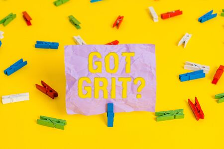Word writing text Got Grit Question. Business photo showcasing A hardwork with perseverance towards the desired goal Colored clothespin papers empty reminder yellow floor background office