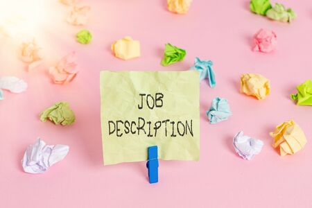 Conceptual hand writing showing Job Description. Concept meaning A document that describes the responsibilities of a position Colored crumpled papers empty reminder pink floor clothespin