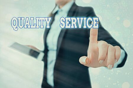 Writing note showing Quality Service. Business concept for how well delivered service conforms to client expectations Standard-Bild