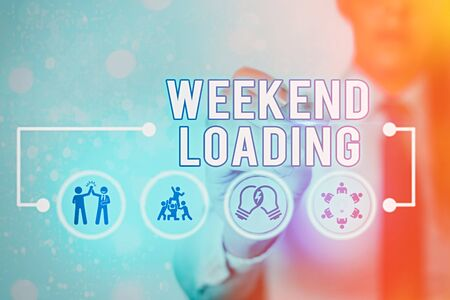 Writing note showing Weekend Loading. Business concept for Starting Friday party relax happy time resting Vacations Фото со стока - 146575347