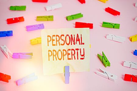 Conceptual hand writing showing Personal Property. Concept meaning Things that you own and can take it with you Movable Colored clothespin papers empty reminder pink floor office pin Reklamní fotografie