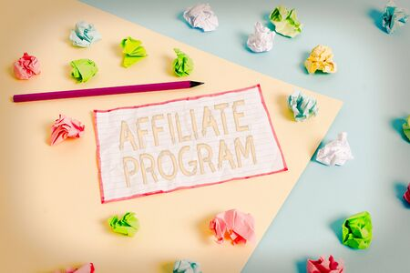 Conceptual hand writing showing Affiliate Program. Concept meaning Automated platform of two or more parties Associated Colored crumpled papers empty reminder blue yellow clothespin