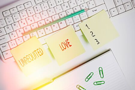 Handwriting text writing Unrequited Love. Conceptual photo not openly reciprocated or understood as such by beloved Three empty green square papers by the pc keyboard with copy space