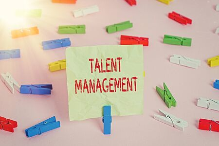 Conceptual hand writing showing Talent Management. Concept meaning Acquiring hiring and retaining talented employees Colored clothespin papers empty reminder pink floor office pin Stock fotó